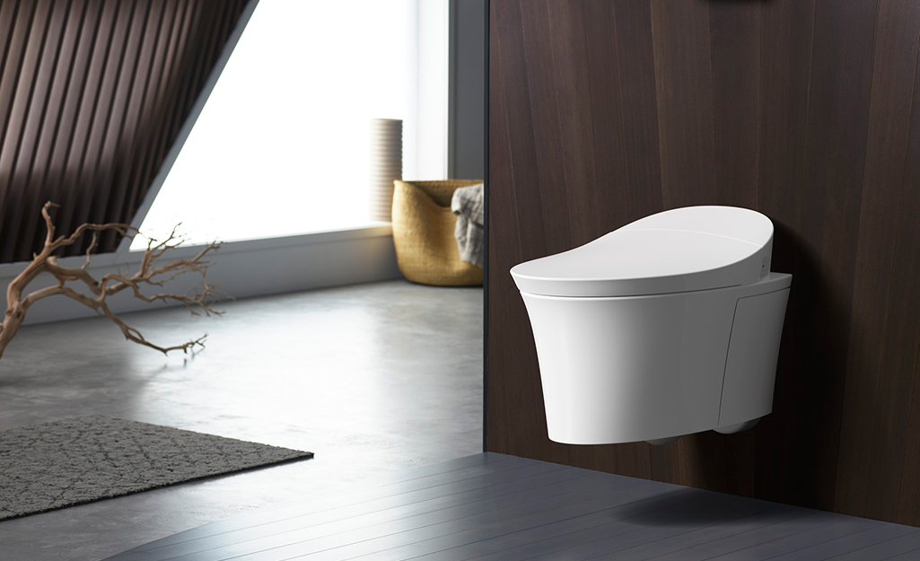 A wall-mounted toilet in a spacious bathroom.