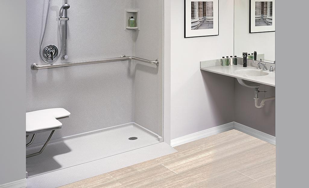 A barrier-free shower in a spacious bathroom.