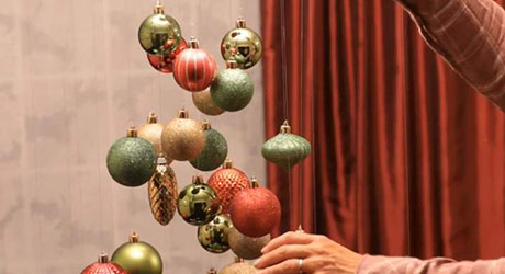Continue hanging ornaments - Christmas Ornament Tree