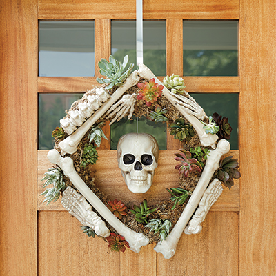 A skeleton wreath hanging on a front door.