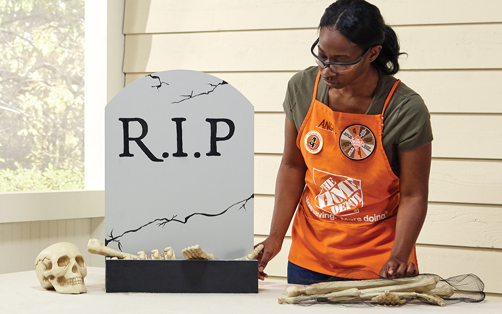 A woman admiring her completed gravestone candy box
