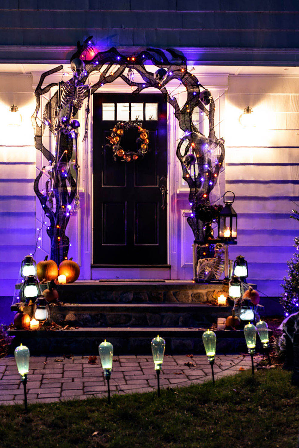 A night view of the front door with halloween lights