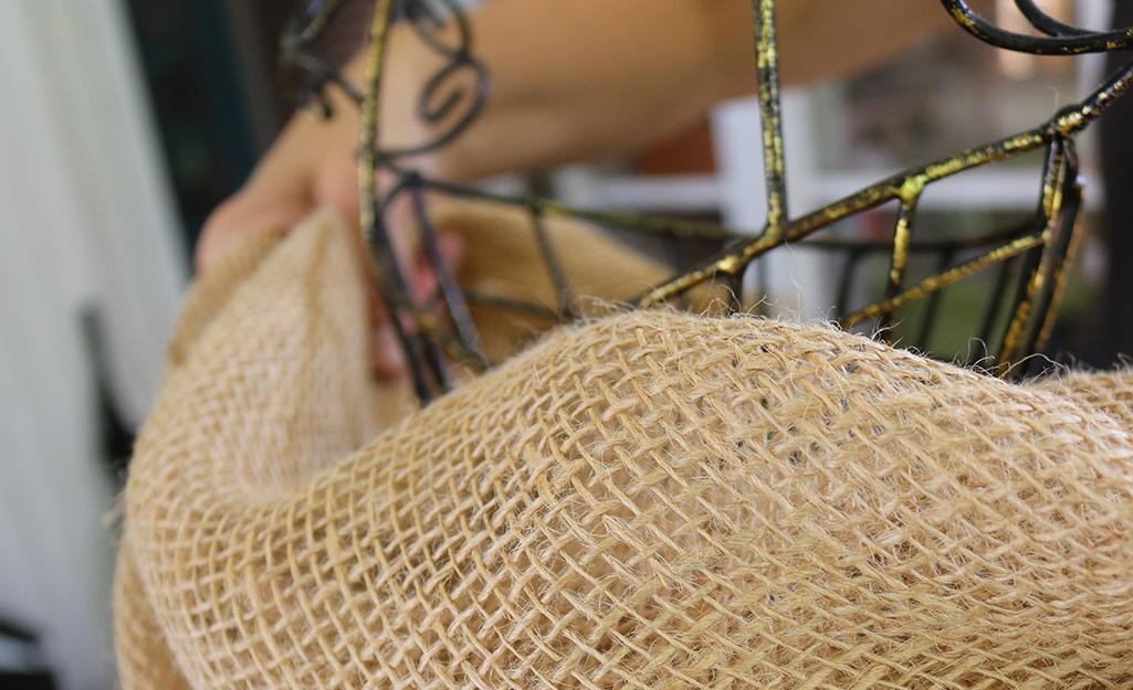 Burlap draped over a dress form to make a bodice.