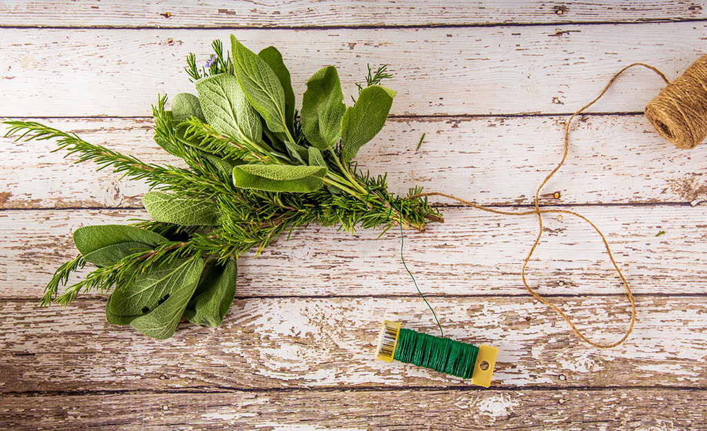 Two herb bundles tied together with twine.