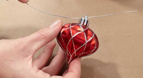 Thread wire through ornaments - Make Ornament Garland