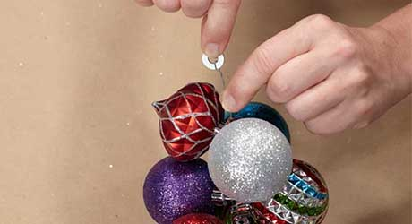 Continue stringing ornaments - Make Ornament Garland