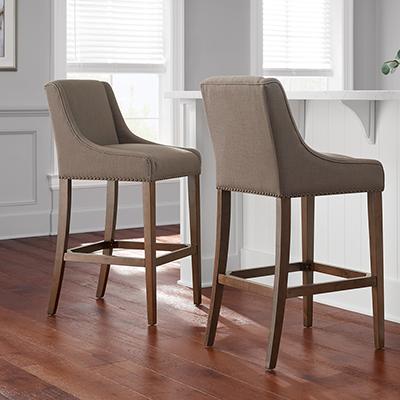 Two bar stools near a bar.