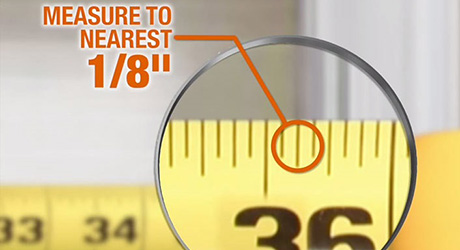 A close up of a measuring tape inch marker