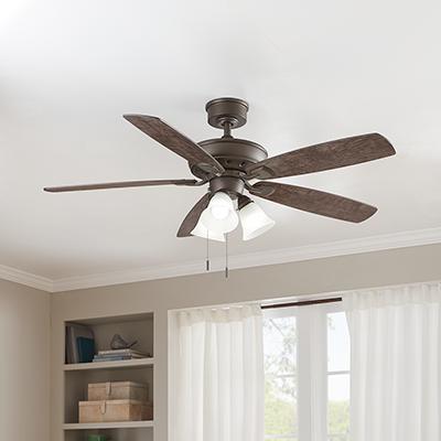 A ceiling fan hangs in a room.