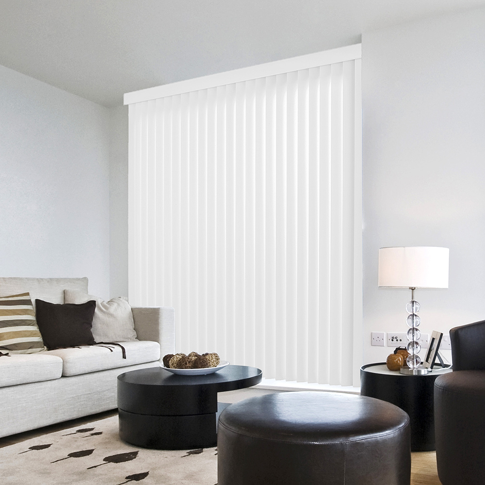 A living room with a large window covered by white vertical blinds.