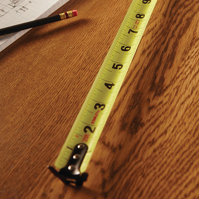 A measuring tape being used to take a measurement.