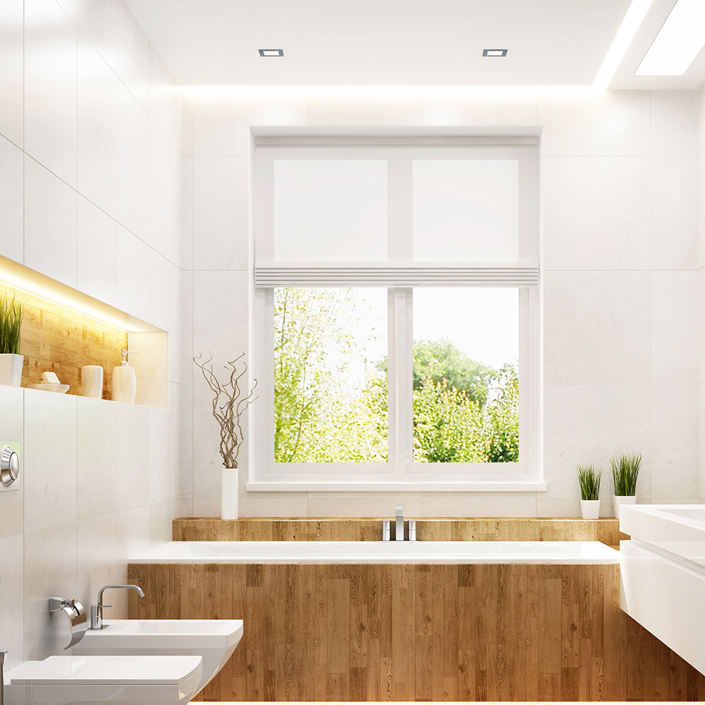 The window in a bathroom is positioned above the bathtub.