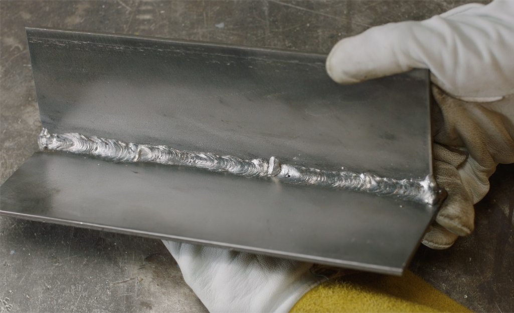 Someone showing a clean MIG weld bead.