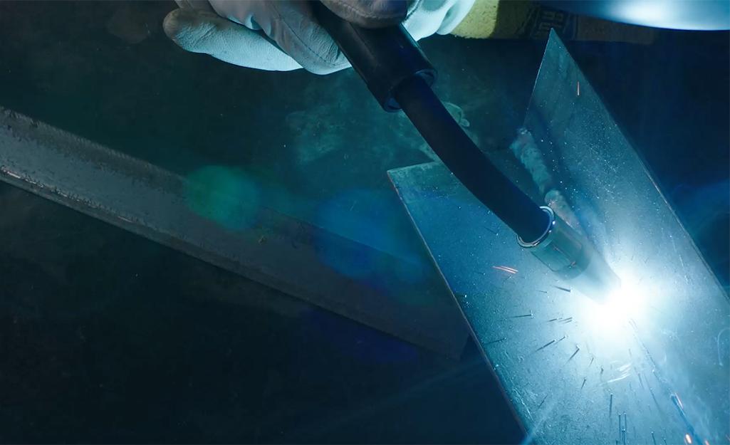 Someone using the push method of MIG welding.