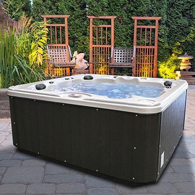 A hot tub sits on a backyard patio.