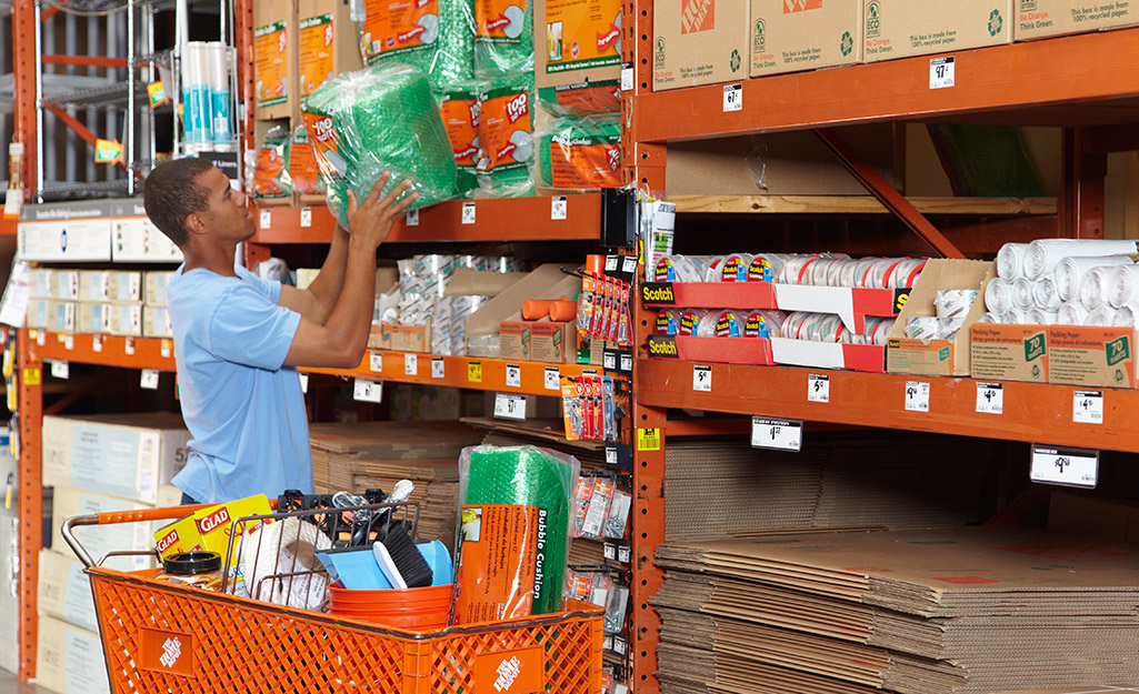A person shopping for moving supplies in The Home Depot