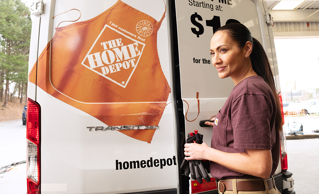 A person opening a The Home Depot moving van