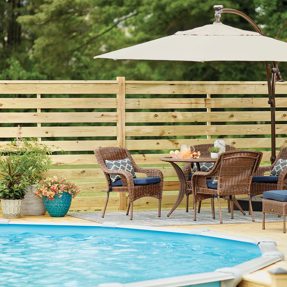 Patio furniture by a pool