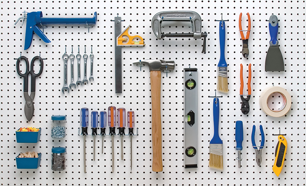 a pegboard with organized tools