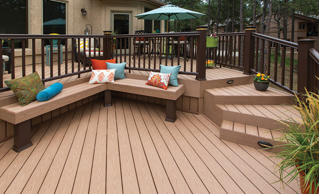 A PVC deck with built-in benches and two levels for eating and entertaining.