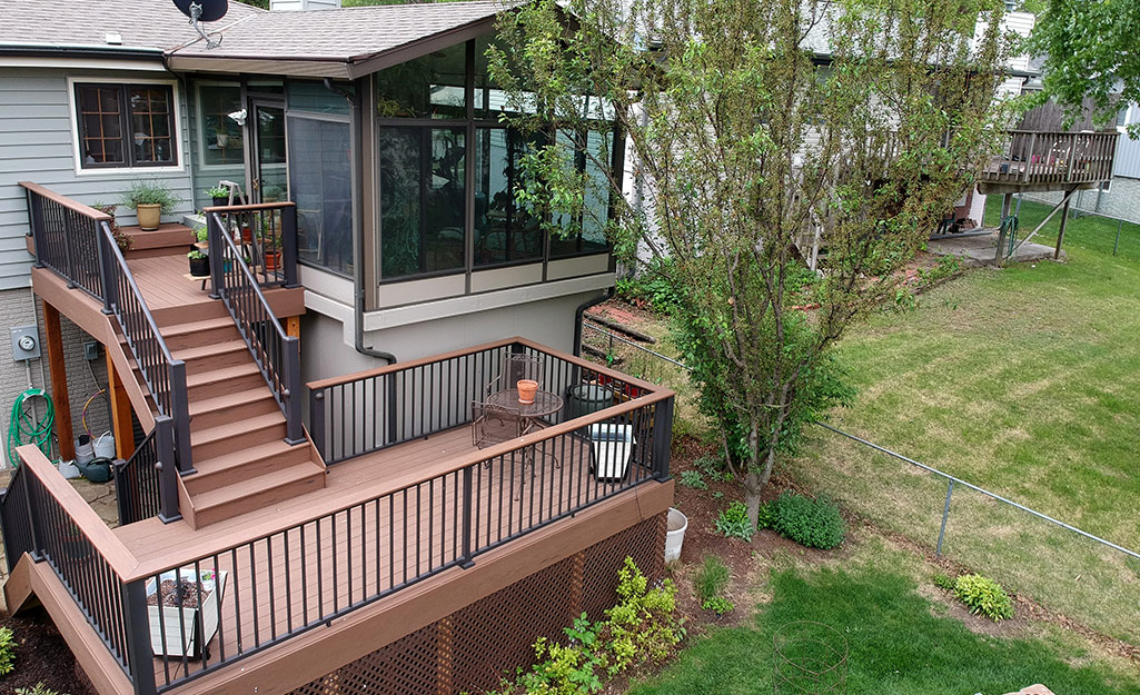 A two-story deck attached to a second-level screened porch.