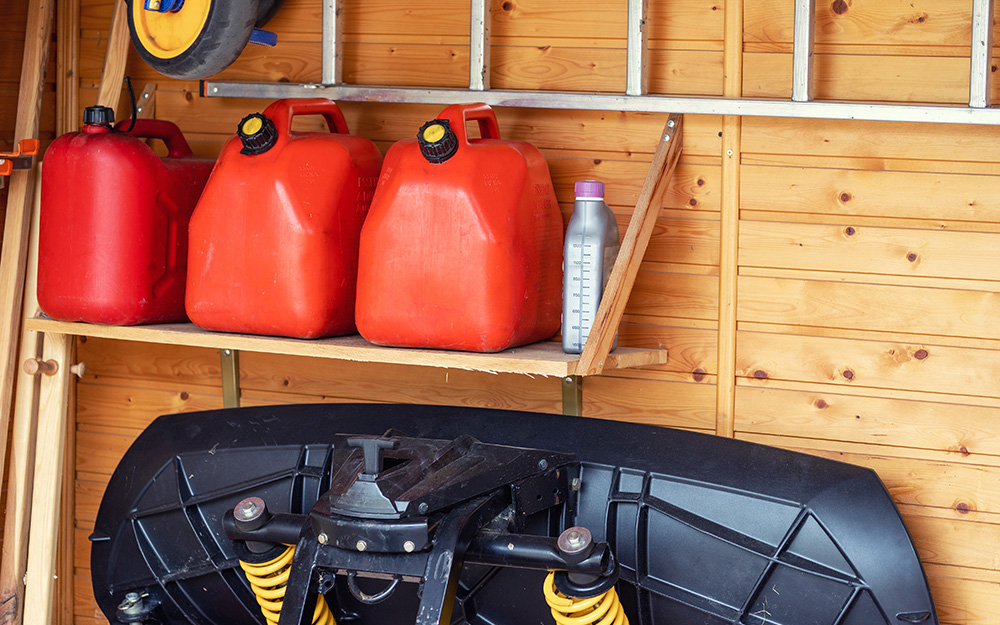 Gasoline containers are stored safely in a garage.