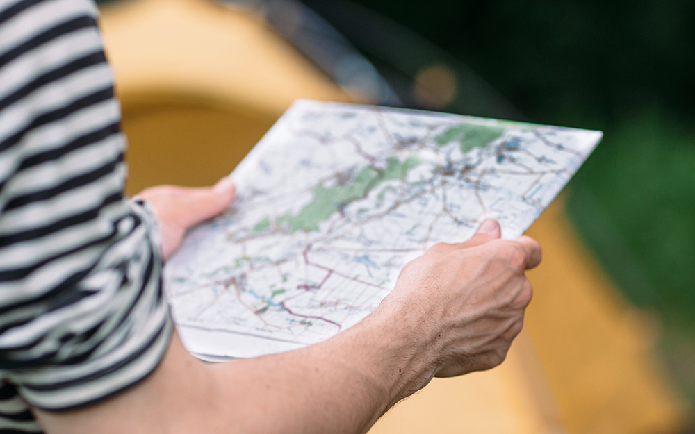 A person reviews an area roadmap.