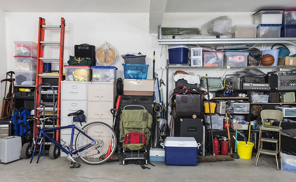 Outdoor possessions are stored securely in a garage.
