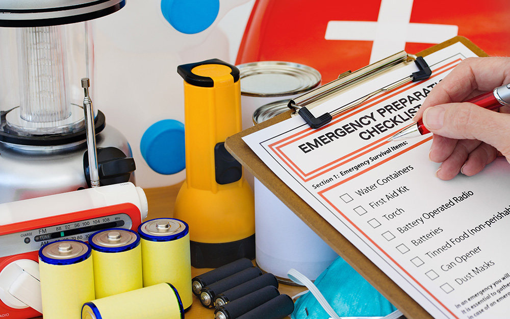 A clipboard holds a checklist of emergency items.