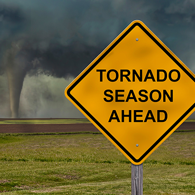 Sign placed in front of a tornado.