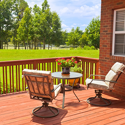Patio furniture sits on a refinished deck.