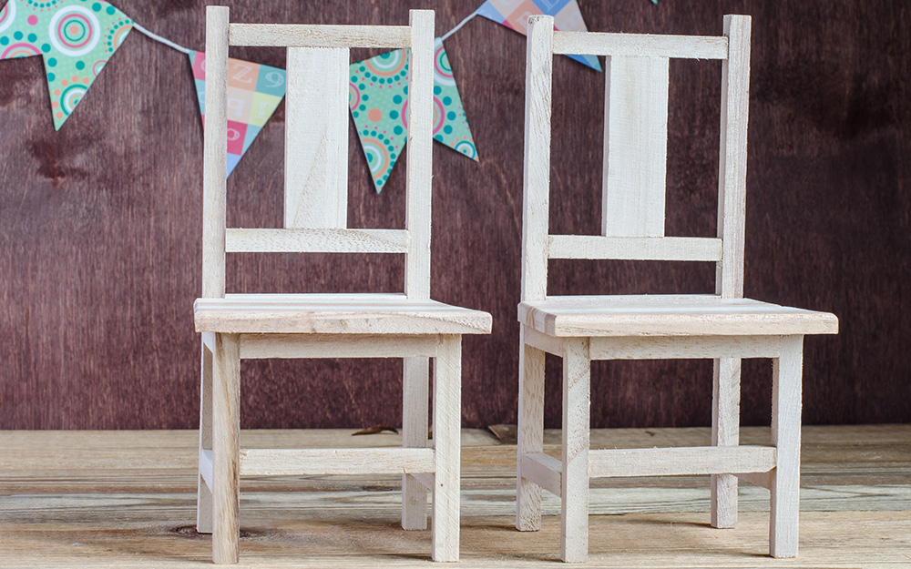 A pair of white painted chairs.