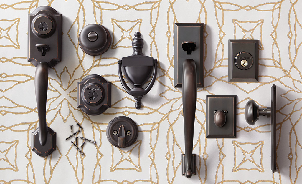 A variety of door knobs on pattern table.