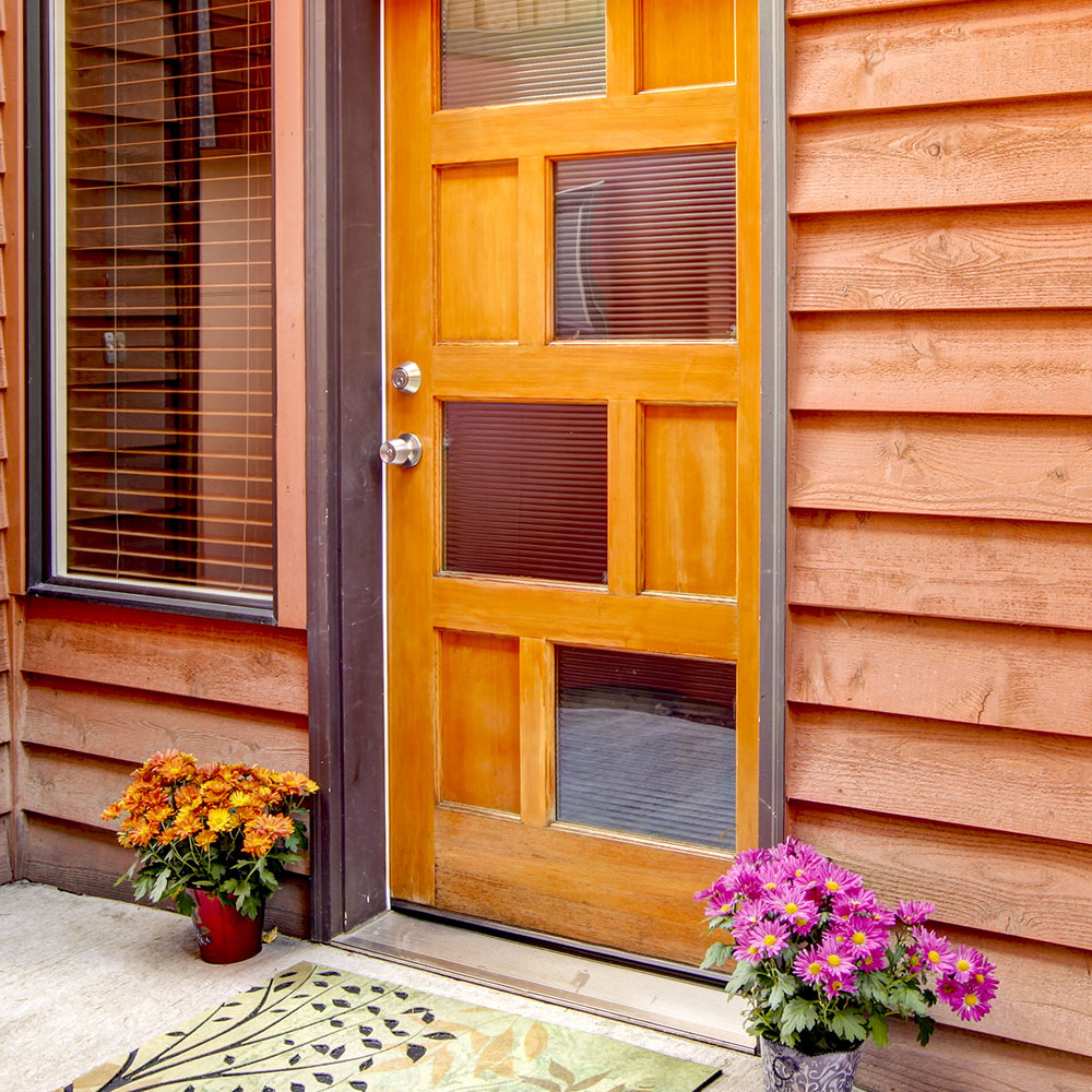 A home's front door with a metal exterior threshold.