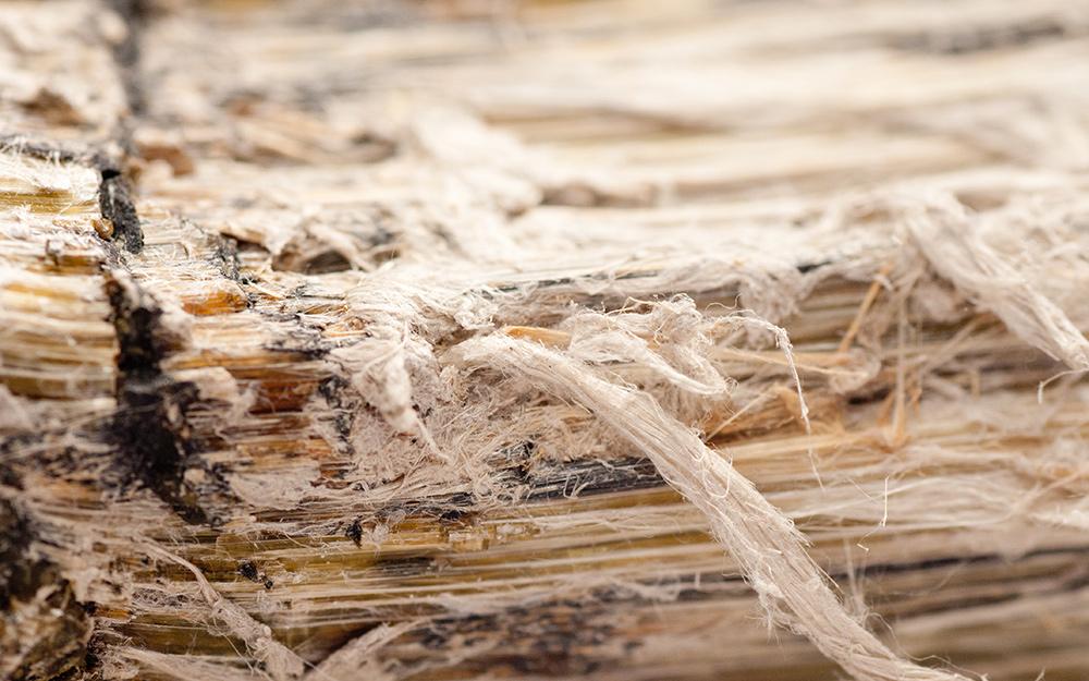 Up close look at asbestos in vinyl flooring.