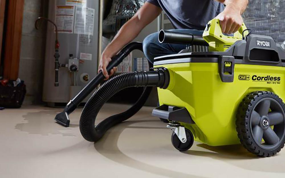 A person vacuuming a floor.
