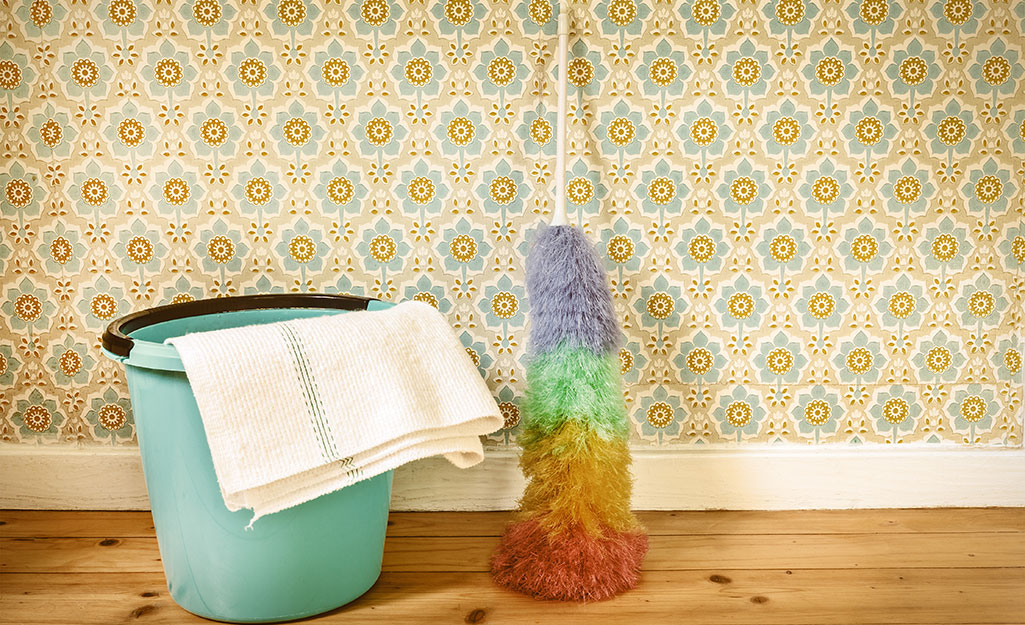 Wallpaper cleaning supplies stand next to a wall.