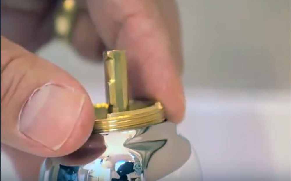 The adjustment ring of a ball faucet is hand-tightened.