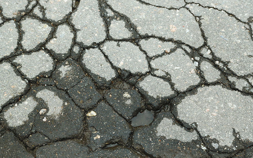 How to Repair Cracks in a Concrete Driveway - The Home Depot