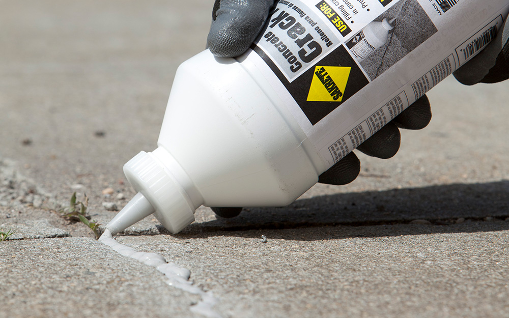 How To Repair S In A Concrete Driveway The Home Depot