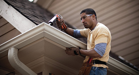 Apply plastic roofing cement - Repairing Metal Gutters