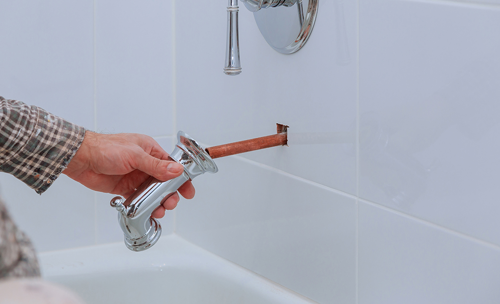 How to Replace a Bathtub Faucet   The Home Depot
