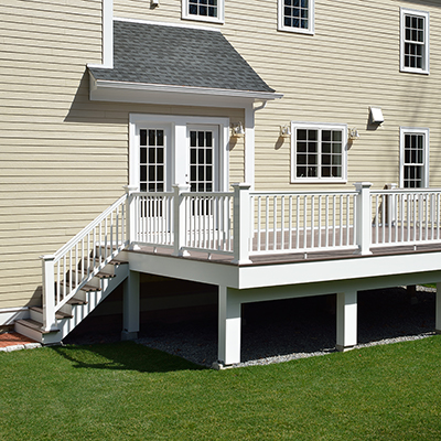 A raised deck with white railing.