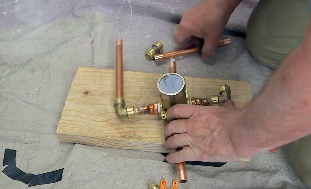 A man assembles a new valve section.