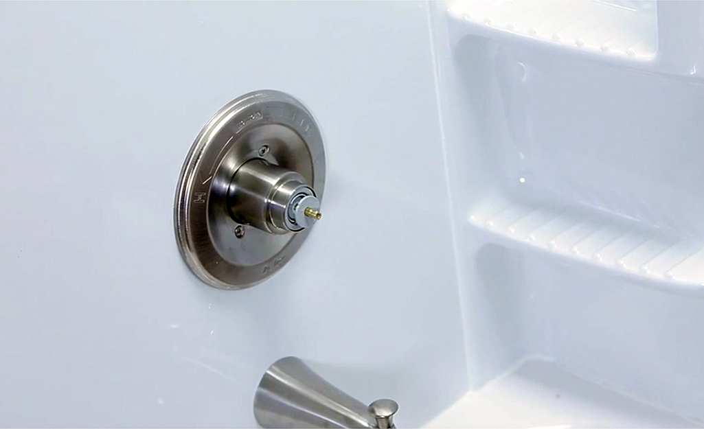 A tub spout without handle attached.