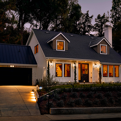 The exterior of a home illuminated by motion sensor lights