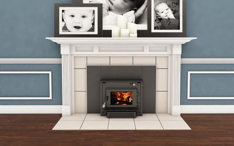a fireplace and mantel featuring a wood burning fireplace insert