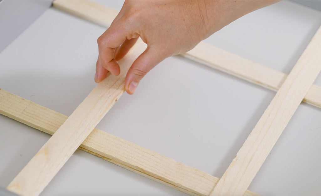 A person arranges shims in a drawer before cutting.