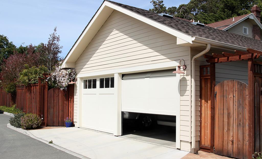 A garage door halfway between the open and closed position.