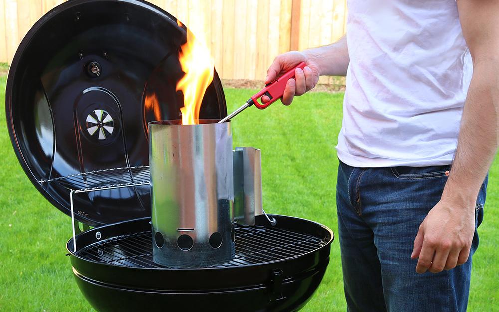 Coals begin to heat up in chimney starter.